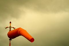 Orange windsock. An orange windsock in the stormy weather Stock Images