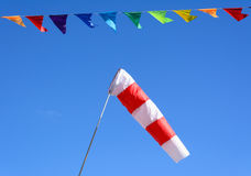 Wind cone and colored flags Royalty Free Stock Photo