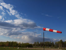 Wind cone. Helipad with wind cone on a background of clouds royalty free stock images