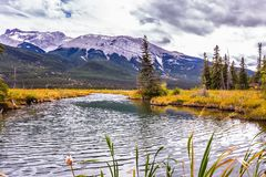 The wind creates a ripple on the lake water. Magnificent journey through the Rocky Mountains of Canada. Concept of active and ecological tourism stock photos