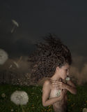 Wind and Dandelion. Beautiful young girl with dandelions, the wind in your hair Stock Photo