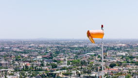 Wind direction indicator on background of city landscape. Air sleeve moving in the wind near helicopter landing place site. Orange. Shot on the Red EPIC Digital stock video footage