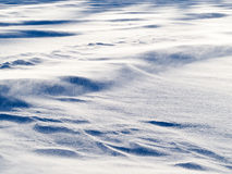 Wind drift snow flying over snow surface refief Stock Photos