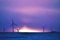 Wind driven electric plant on snow Royalty Free Stock Photography