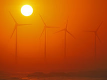Wind-driven generator and golden sunset Royalty Free Stock Photography