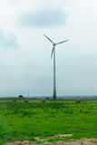 Wind-driven generator in the middle of a field Royalty Free Stock Photography