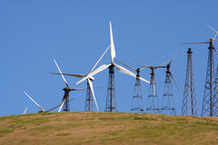 Wind-driven generators & cell site. Several wind-driven generators atop a hill in California, USA Stock Image