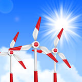 Wind driven generators, turbines over blue sky Royalty Free Stock Image
