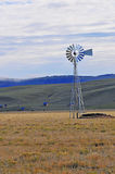 Wind driven water pump on Farm Stock Photo