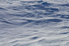 Wind effected snow cover with strong shadows Stock Photo