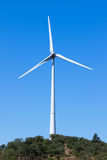 Wind electric generator against blue sky Royalty Free Stock Images
