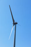Wind electric generator against blue sky Royalty Free Stock Photography