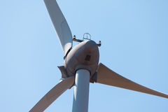 Wind electric generator against blue sky background Royalty Free Stock Images