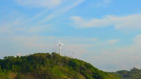 Wind electric generator on top of the hill by the sea. Clean energy concept. renewable energy source.  stock footage