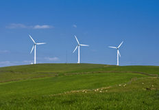 Wind Energie. Wind turbines farm on the hills in Wales, UK. Alternative energy source stock photography