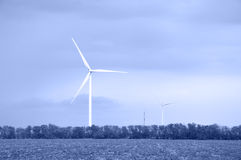 Wind energie. Alternative energy wind turbines. Toned royalty free stock image