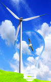Wind Energy. Clean energy concept with green field and wind turbine Stock Image