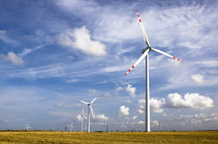 Wind energy. Environmental friendly alternative energy by wind turbines Royalty Free Stock Photo