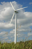 Wind Energy. A wind-powered generator in a field Stock Images