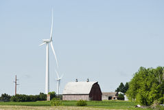 Wind Energy. Wind turbines located on farmland near Lake Benton Minnesota with transmission lines in the background Stock Photography