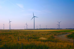 Wind energy. Environmental friendly alternative energy by wind turbines Royalty Free Stock Image