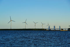 Wind energy. Wind turbines at the entrance to the Ijsselmeer from the Markermeer in the Netherlands Stock Photography