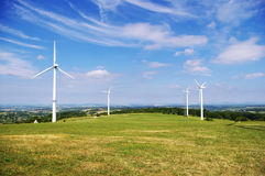 Wind energy. Turbines generating clean energy Stock Images