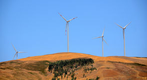 Wind energy. Clean energy from the wind farms Stock Photo
