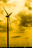 Wind Energy. Silhouettes Of Wind Turbines Converting Wind Energy To Electricity Stock Photos