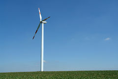 Wind energy. Wind turbines generating healthy environmentally green energy Royalty Free Stock Photo