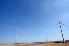 Wind energy. Wind turbines generating healthy environmentally green energy Royalty Free Stock Photography