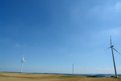 Wind energy. Wind turbines generating healthy environmentally green energy Royalty Free Stock Photos