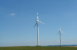 Wind energy. Wind turbines generating healthy environmentally green energy Royalty Free Stock Image