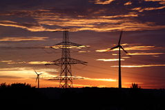 Wind energy. Energy, windmills and power lines in the sunrise Stock Photo