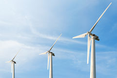 Wind Energy Blows Into Future Amarillo. And Turbine Farms On Blue Sky Background Stock Images