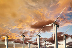 Wind Energy Blows Into Future Amarillo. And Turbine Farms On Blue Sunset In Twilight Background Stock Images