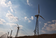 Wind energy for a clean environment. A group of wind energy plants in the country Royalty Free Stock Photos
