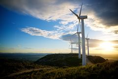 Wind energy concept. Windmills for electric power production at sunset, Zaragoza Province, Aragon, Spain Stock Photos