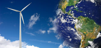 Wind energy conception. Wind generator isolated on blue sky, the globe part of the image comes from NASA: http://visibleearth.nasa.gov Stock Images