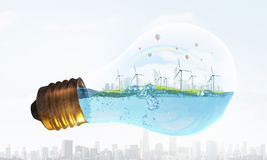 Wind energy. Eco energy concept with windmills inside of light bulb Royalty Free Stock Images