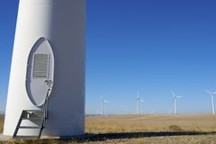 Wind energy. Entrance to a windmill for electric energy production, Zaragoza, Aragon, Spain stock photography