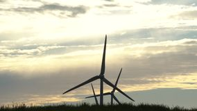 Wind energy generation. Clean and renewable electricity energy resource. S. Cloudy and sunny sky. Dramatic color grading effect. Static shot stock video
