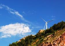 Wind energy generator on summit Stock Photos