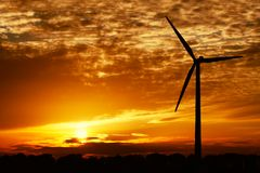 Wind energy and golden sunset royalty free stock photography