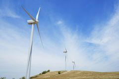 Wind energy. Group of windmills for renewable electric energy production royalty free stock images
