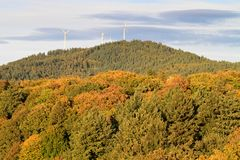 Wind energy mills over forest Stock Photo