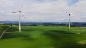 Wind energy plant - modern wind power station on a hill - clean energy. Videoclip stock video footage