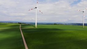 Wind energy plant - modern wind power station on a hill - clean energy. Videoclip stock video