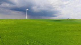 Wind energy plant - modern wind power station on a hill - clean energy. Videoclip stock footage