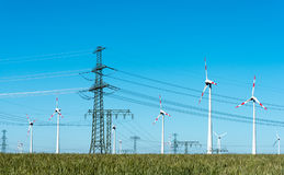 Wind energy and power transmission lines in Germany. Wind energy and power transmission lines seen in rural Germany Royalty Free Stock Photography